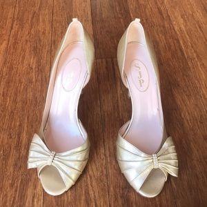 SJP gold heels